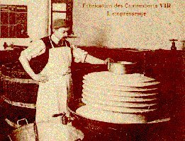 Adding the rennet in the VIR dairy. Old postcard.